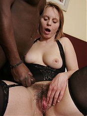 Horny mature Magda sucking off a big black cock and taking it inside her snatch live