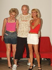 Rosalie and Ritta show off their flabby asses and lure a younger guy into banging them live